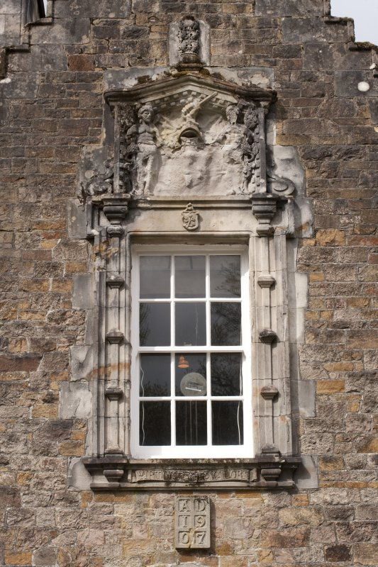 Detail of window with armorial panel above east entrance