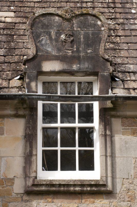Detail of south dormer window with carved stone pediment at 1st floor level of east facade