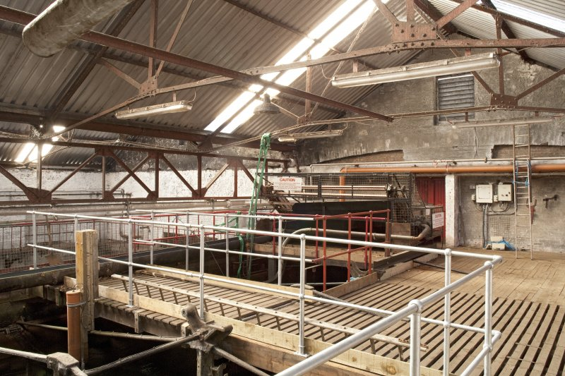 Interior. Turbine house, upper level, view showing top of lade