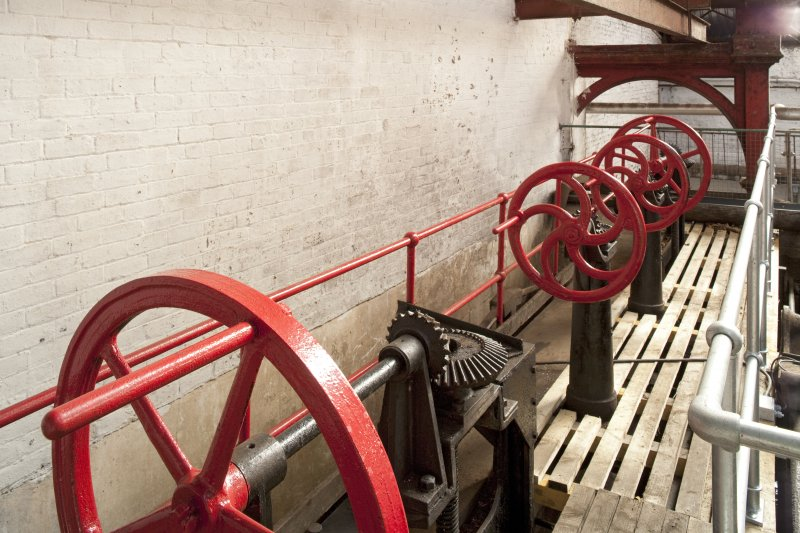 Interior. Turbine house, upper level, detail of lade control wheels