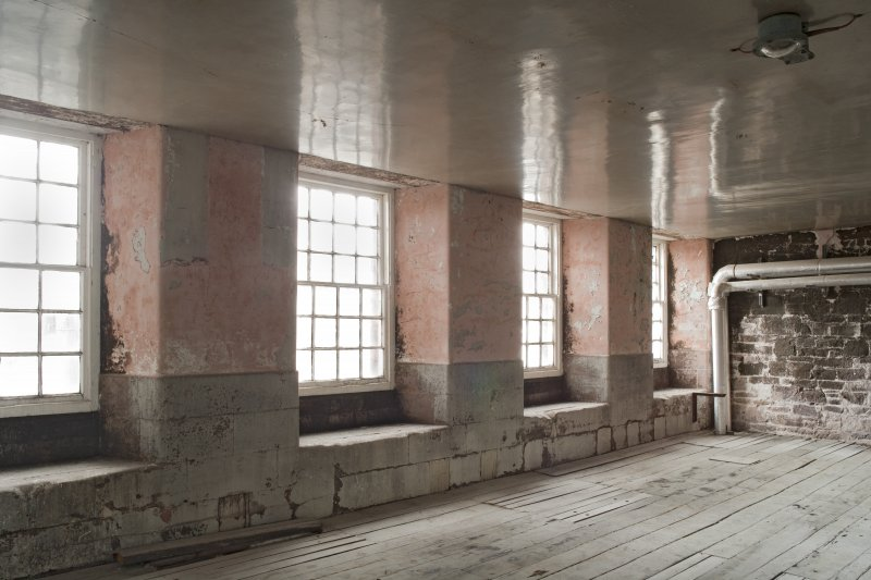 Interior. Spinning mill, 2nd floor, main room, view of windows at south end
