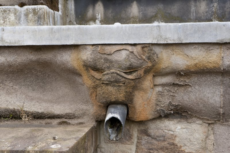 Parapet of tower, detail of carved water spout at west end