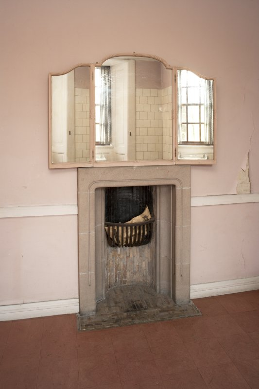 Interior. 2nd floor, north bathroom, view of fireplace with mirror above