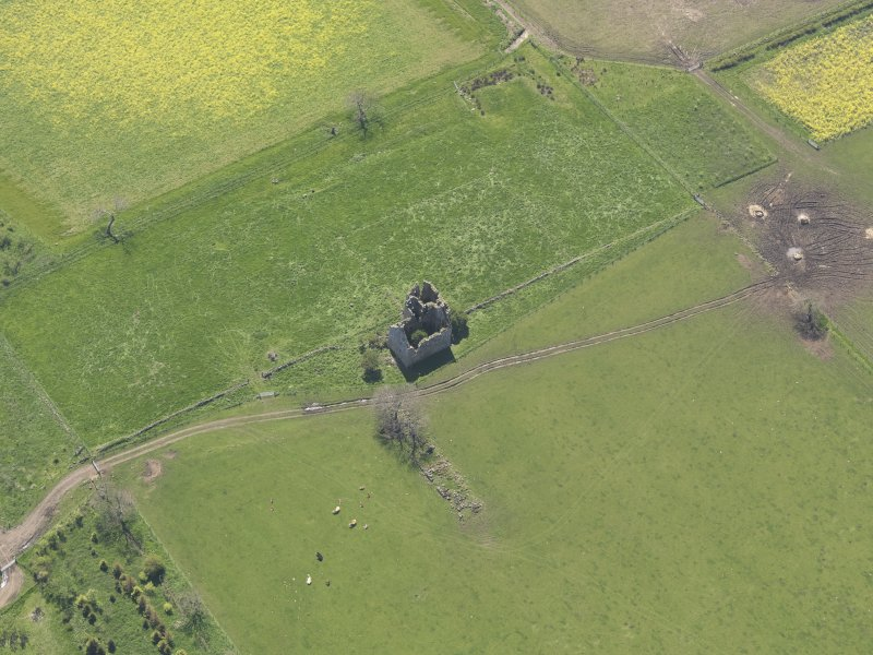 Oblique aerial view of Pittarthie Castle, taken from the NE.