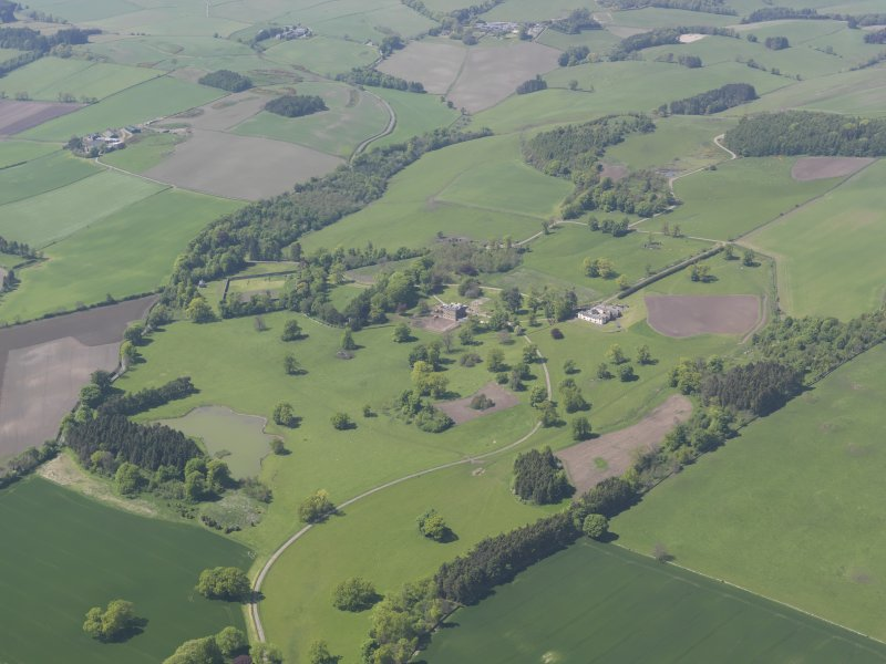 General oblique aerial view of Pitlour House policies centred on the house, taken from the SE.