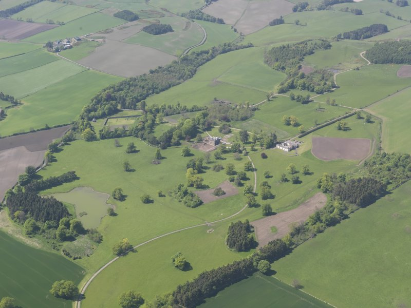 General oblique aerial view of Pitlour House policies centred on the house, taken from the E.
