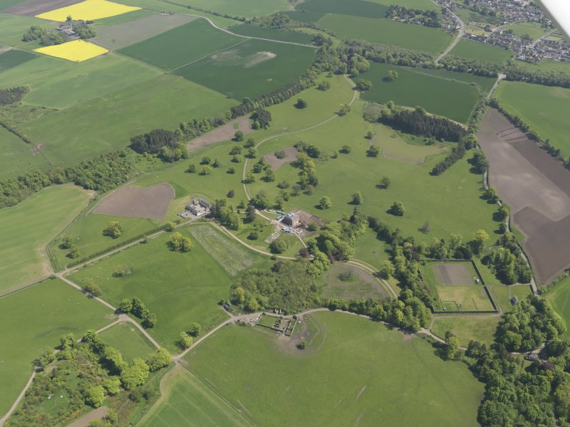 General oblique aerial view of Pitlour House policies centred on the house, taken from the WNW.