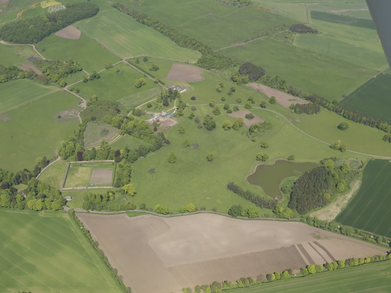 General oblique aerial view of Pitlour House policies centred on the house, taken from the S.