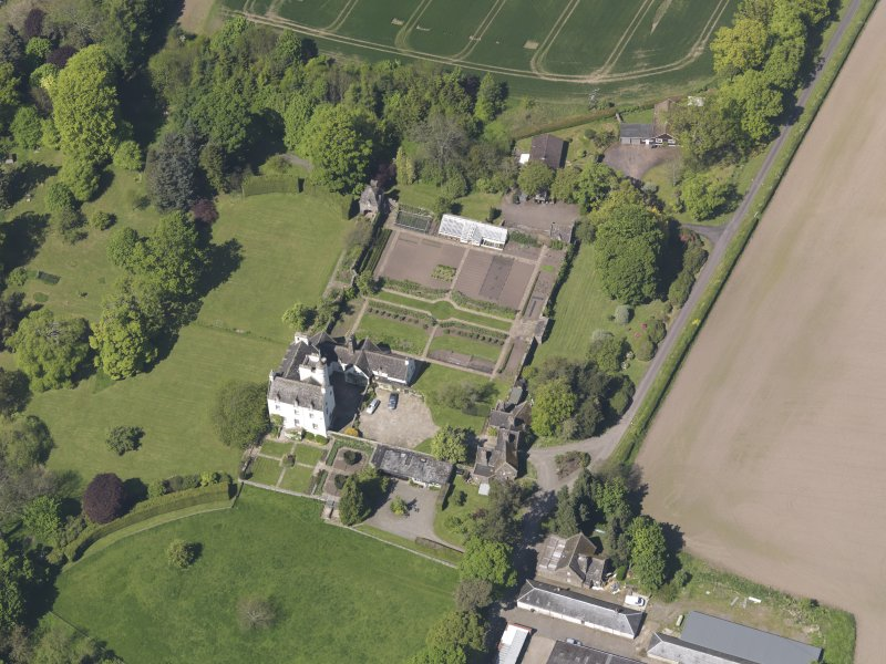 Oblique aerial view of Balmanno Castle, taken from the S.