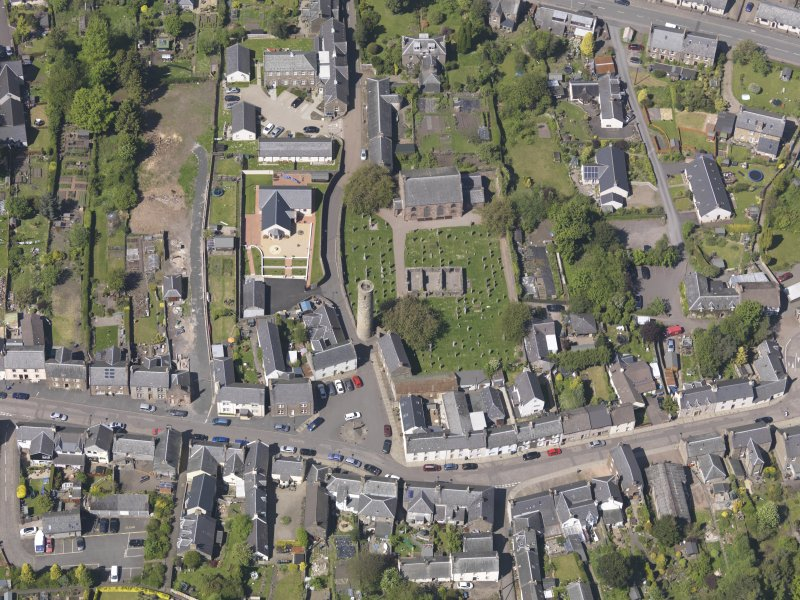 General oblique aerial view of Abernethy centred on the Kirk of St Bride, taken from the SSE.