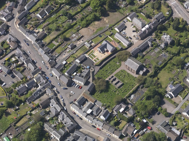 General oblique aerial view of Abernethy centred on the Kirk of St Bride, taken from the SE.