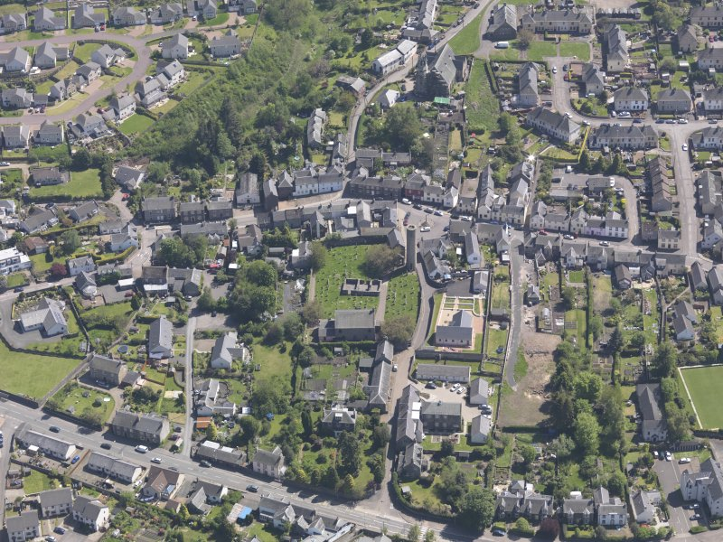 General oblique aerial view of Abernethy centred on the Kirk of St Bride, taken from the NW.