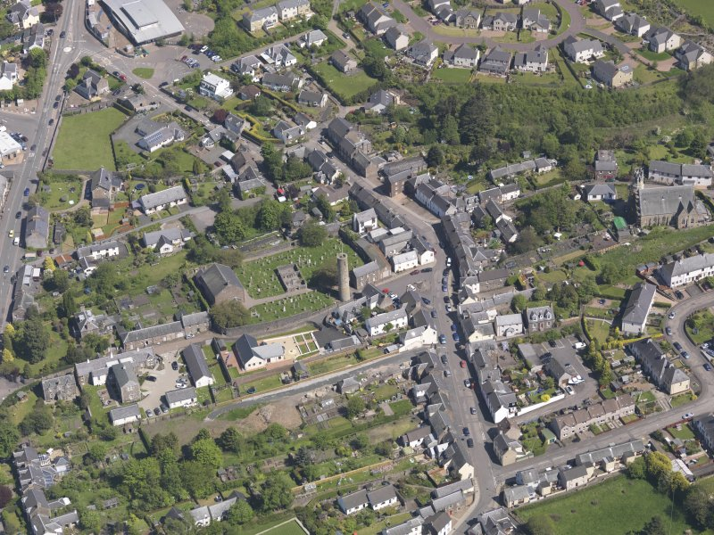 General oblique aerial view of Abernethy centred on the Kirk of St Bride, taken from the WSW.