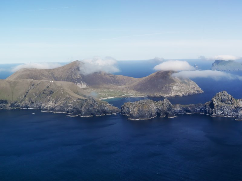 General oblique aerial view of St Kilda, centred on Village Bay and the island of Dun, taken from the SSW.