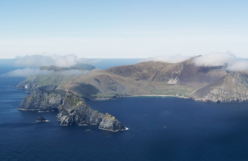 General oblique aerial view of St Kilda, centred on Village Bay and the island of Dun, taken from the SSE.