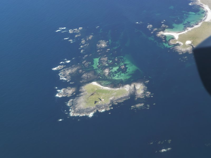 General oblique aerial view of the lighthouse on Siolaigh, Monach Isles, taken from the WSW.