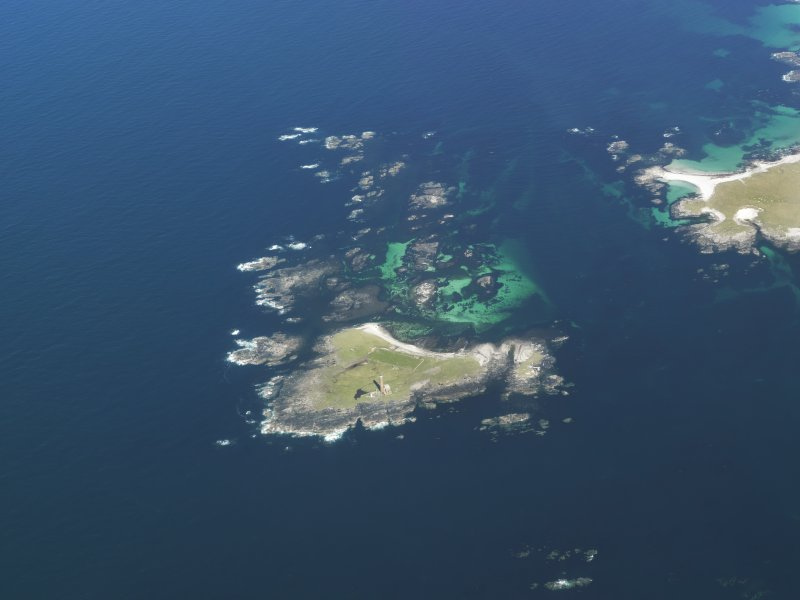General oblique aerial view of the lighthouse on Siolaigh, Monach Isles, taken from the SW.