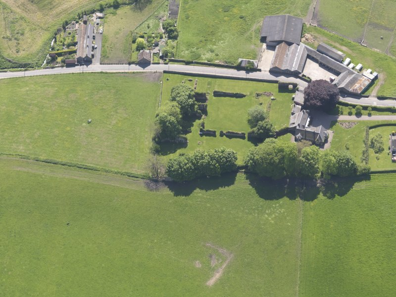 Oblique aerial view of Lindores Abbey, taken from the NW.