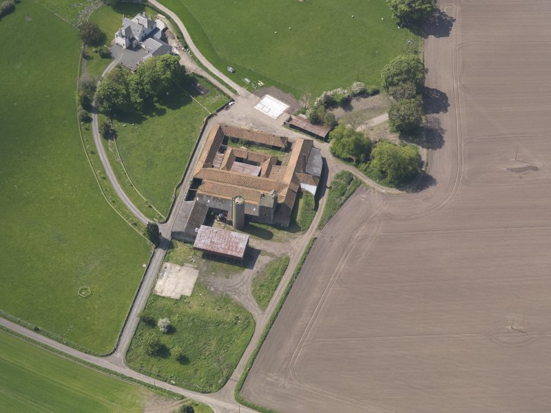 Oblique aerial view of Collairnie Castle and steading, taken from the NE.