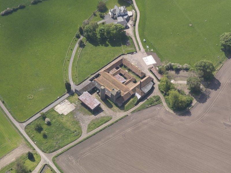 Oblique aerial view of Collairnie Castle and steading, taken from the N.