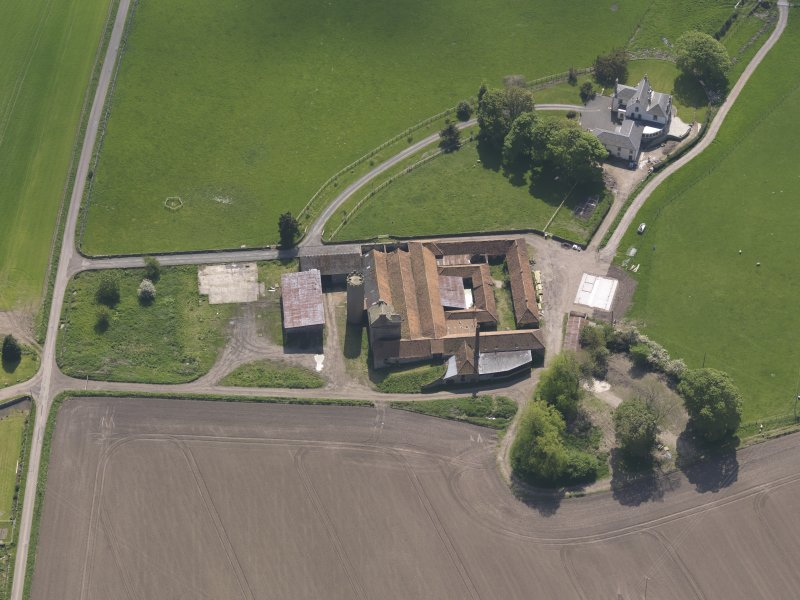 Oblique aerial view of Collairnie Castle and steading, taken from the NW.