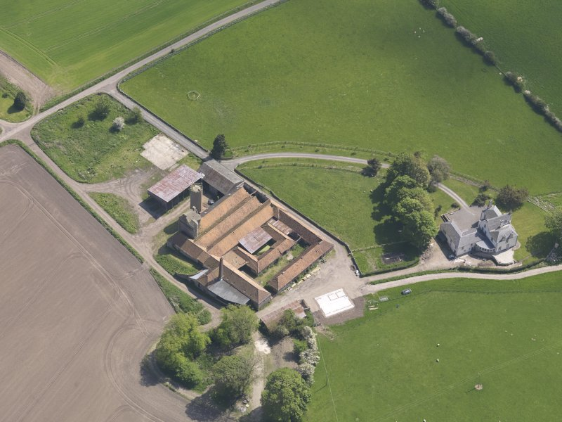 Oblique aerial view of Collairnie Castle and steading, taken from the W.
