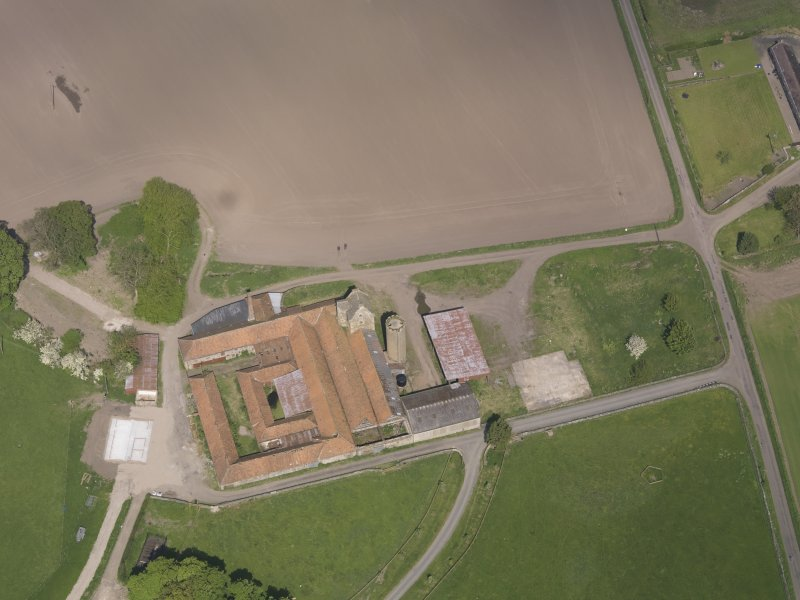 Oblique aerial view of Collairnie Castle and steading, taken from the SSE.