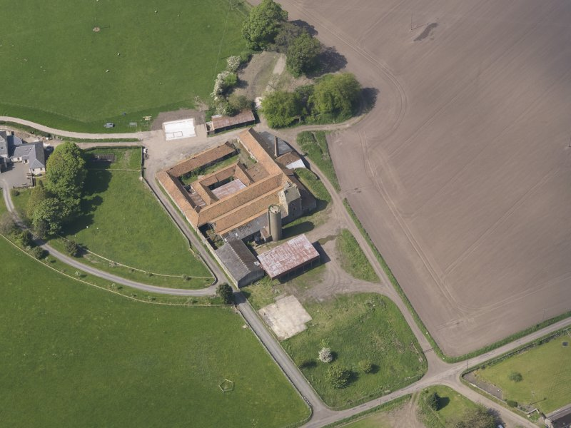 Oblique aerial view of Collairnie Castle and steading, taken from the E.