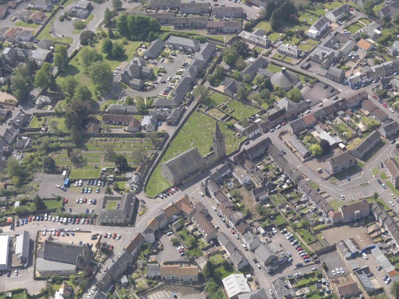 Oblique aerial view of Old and St Michael of Tarvit Parish Church, taken from the N.