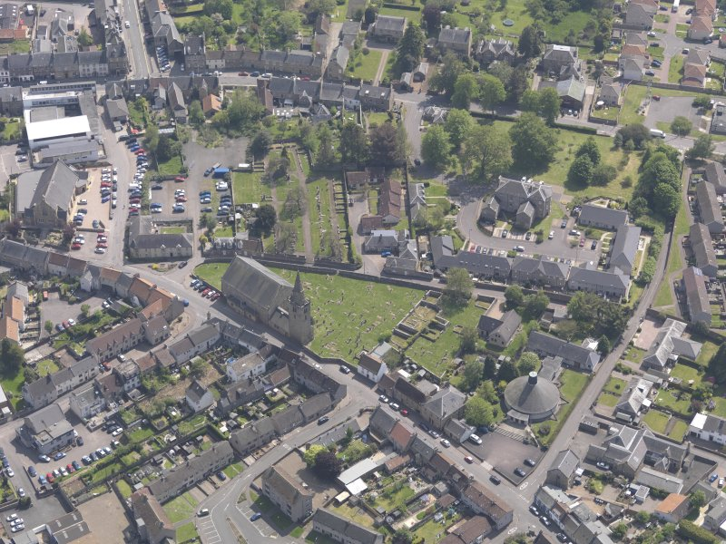 Oblique aerial view of Old and St Michael of Tarvit Parish Church, taken from the W.