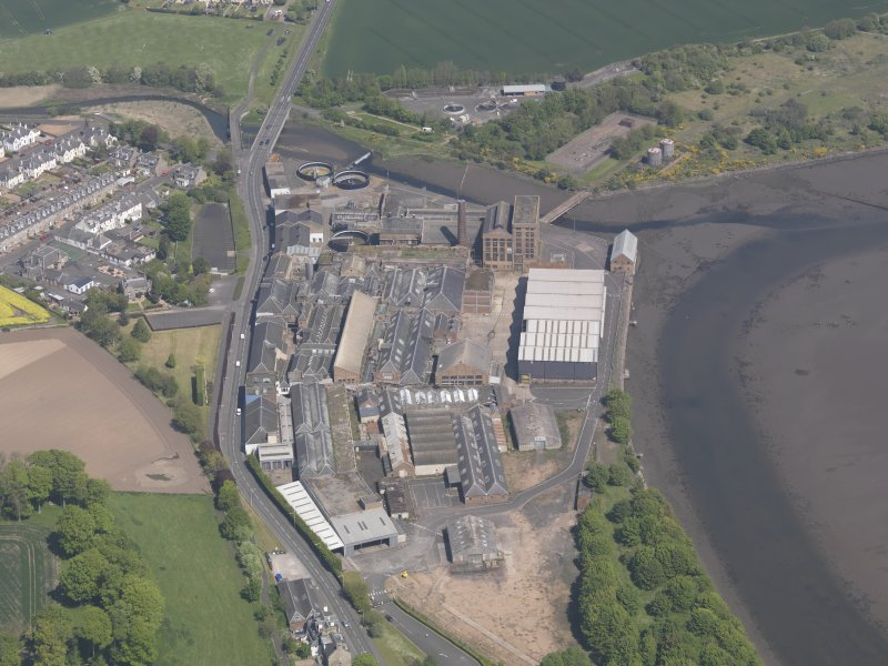 Oblique aerial view of Guardbridge Paper Mill, taken from the S.
