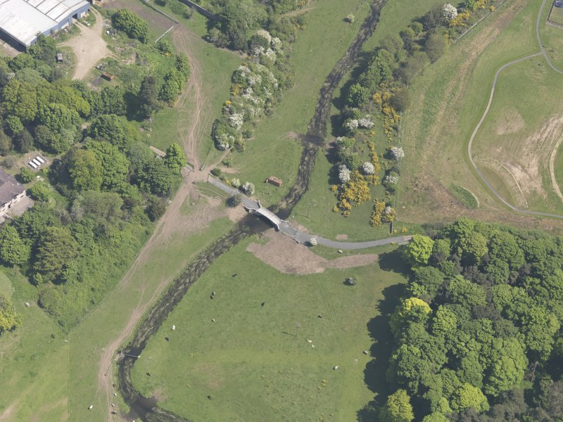 Oblique aerial view of Linlathen House East Bridge, taken from the SW.