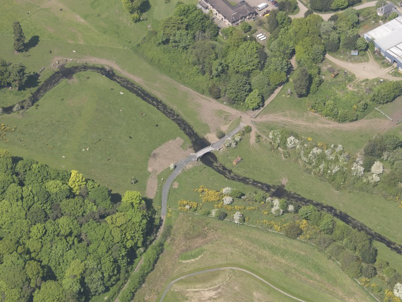 Oblique aerial view of Linlathen House East Bridge, taken from the E.