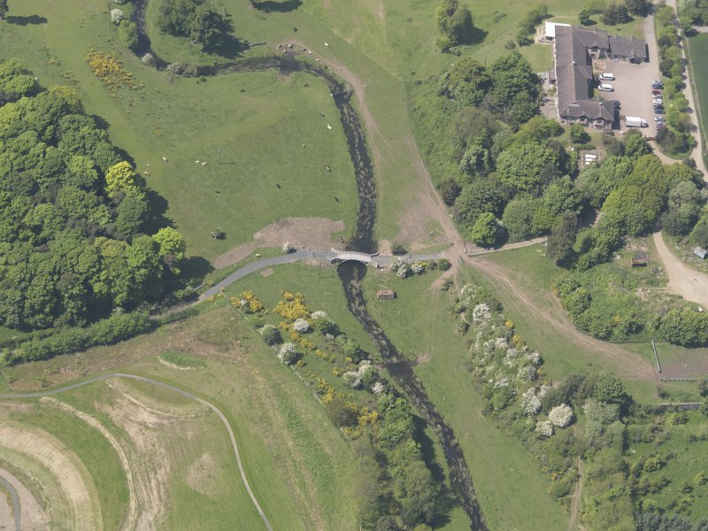 Oblique aerial view of Linlathen House East Bridge, taken from the ENE.