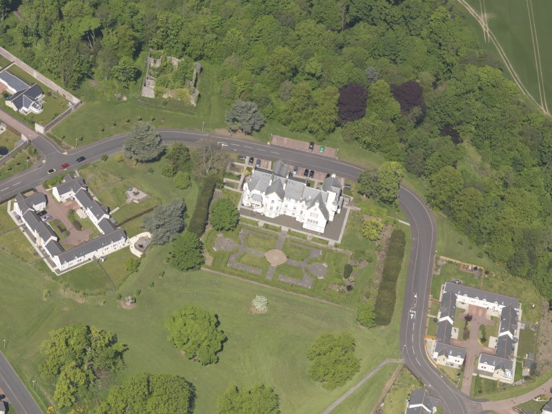 Oblique aerial view of Ballumbie Castle, taken from the SE.