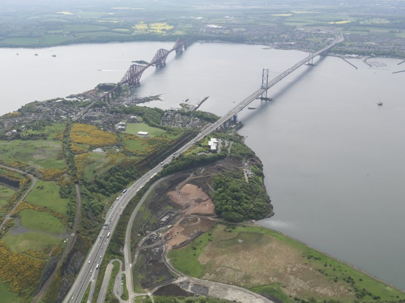General oblique aerial view of the Forth bridges and the new crossing works site, taken from the WNW.