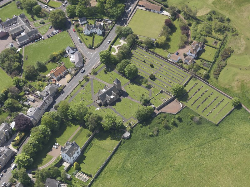 Oblique aerial view of Aberlady Parish Church, taken from the NE.