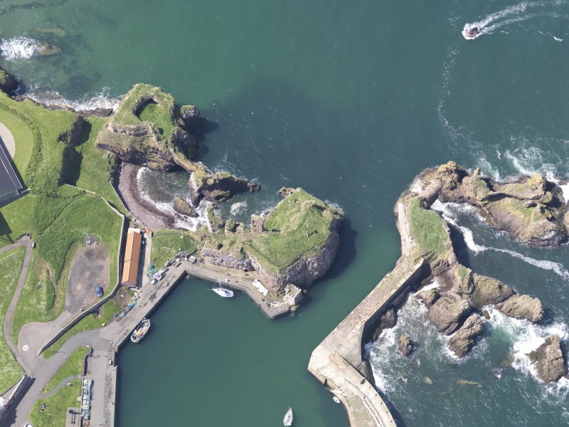 Oblique aerial view of Dunbar Castle, taken from the E.