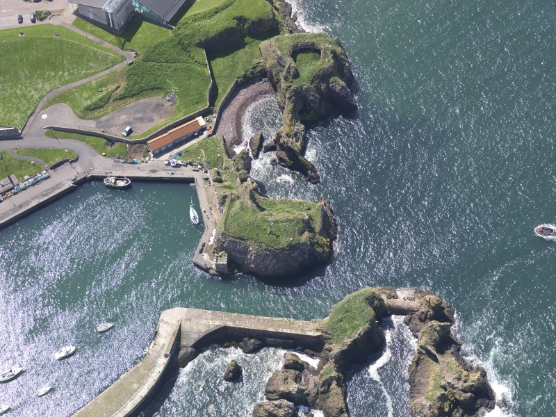 Oblique aerial view of Dunbar Castle, taken from the NE.