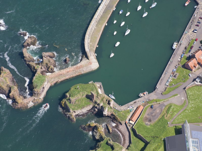 Oblique aerial view of Dunbar Castle, taken from the SW.