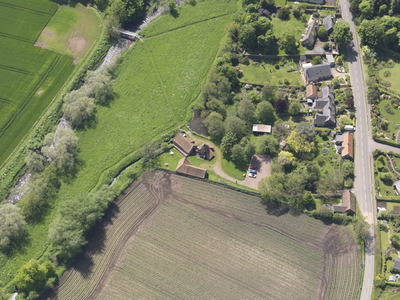 Oblique aerial view of Preston Mill, taken from the NE.