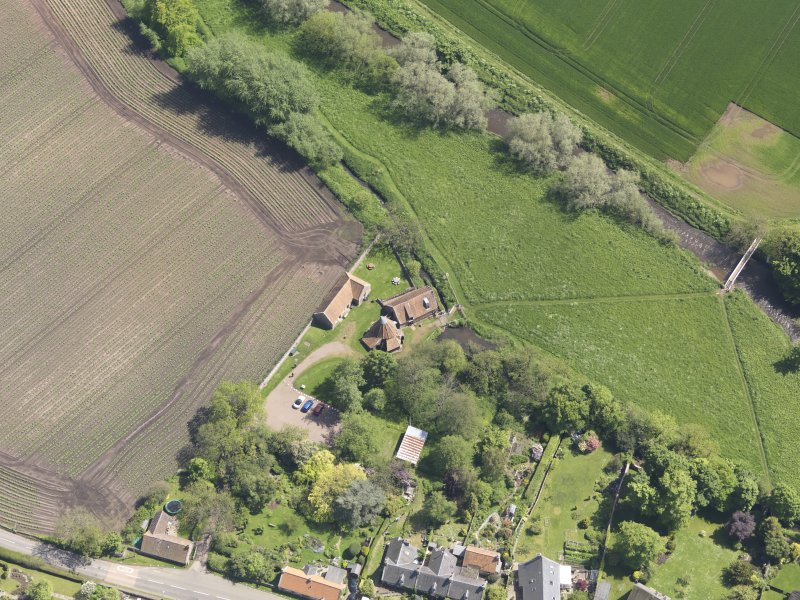 Oblique aerial view of Preston Mill, taken from the NW.