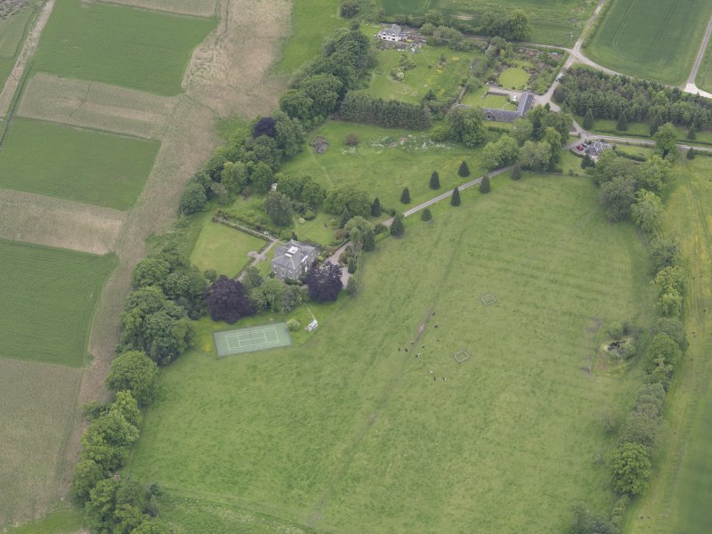 Oblique aerial view of Seaside House, taken from the NE.