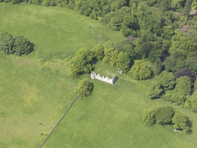 Oblique aerial view of Dowhill Castle, taken from the SE.