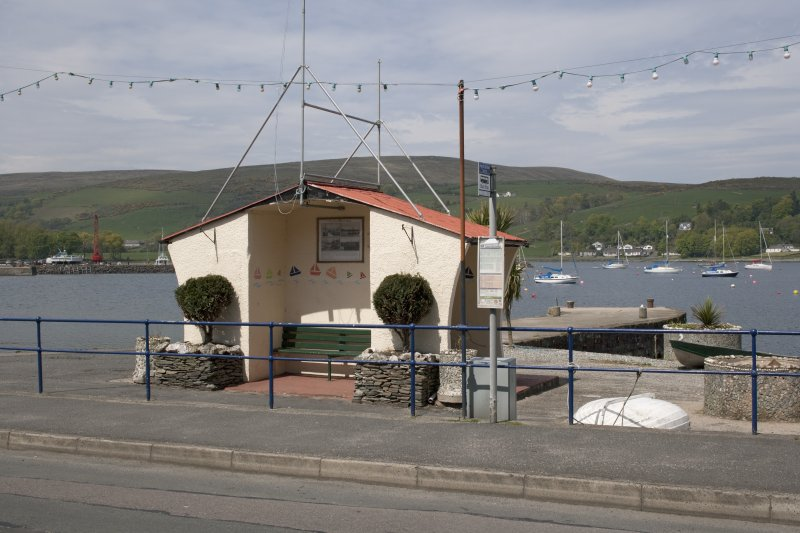 View from S showing bus shelter and Quay, Marine Road, Port Bannatyne, Bute