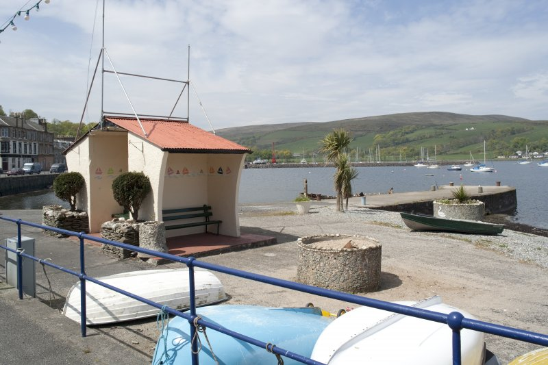 View from SE showing bus shelter and Quay, Marine Road, Port Bannatyne, Bute