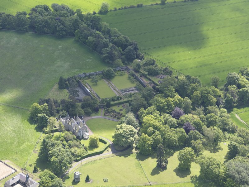Oblique aerial view of Huntingdon House, taken from the NW.