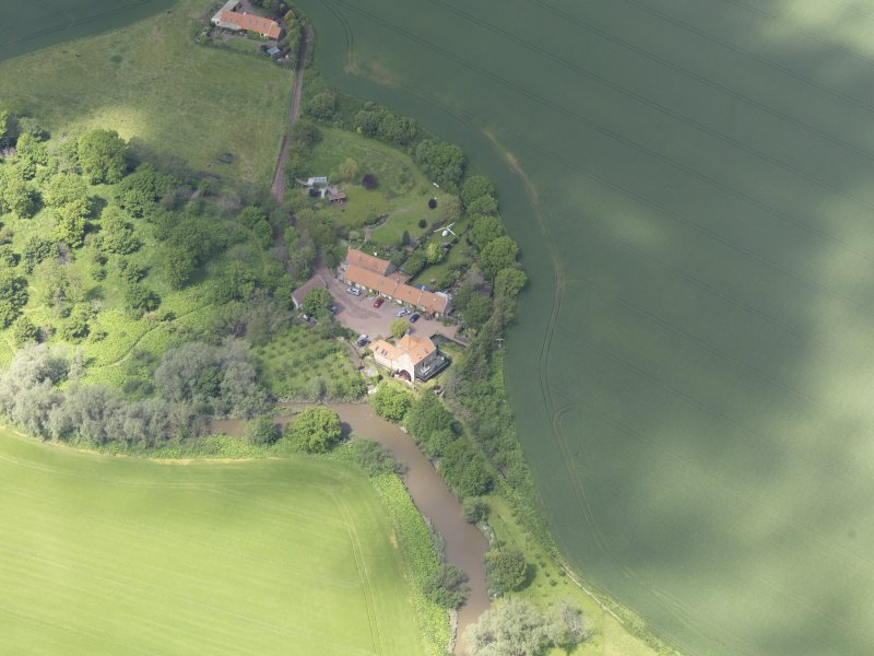 Oblique aerial view of Sandy's Mill, taken from the SE.