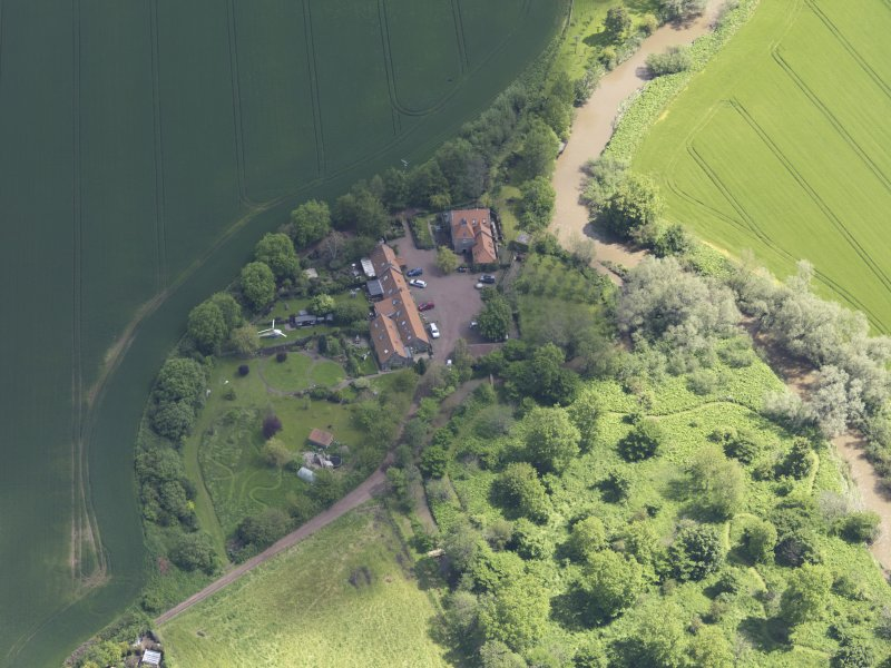 Oblique aerial view of Sandy's Mill, taken from the W.