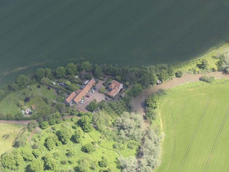 Oblique aerial view of Sandy's Mill, taken from the SW.
